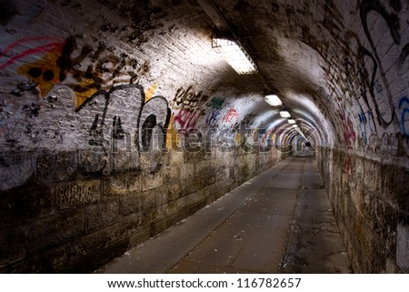 abandoned graffiti tunnel - stock photo