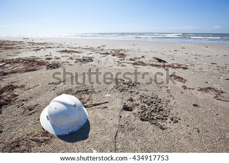Abandoned Hard Hat on a Beach in Southern Louisiana - stock photo