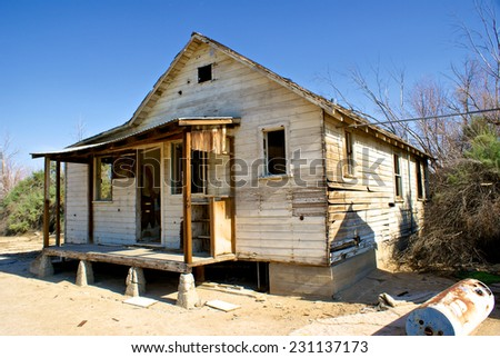 Abandoned home lies aging in the hot sun in the dry arid desert. - stock photo