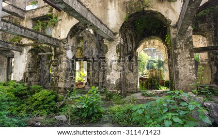 Abandoned house and ruined city wet and muddy in Manila, Philippines. - stock photo