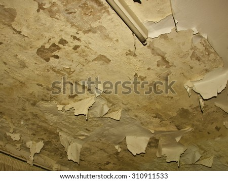 Abandoned house. Grunge texture in the ceiling - stock photo