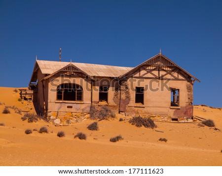 Abandoned house in Kolmanskop ghost village (Namibia) - stock photo