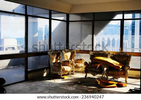 Abandoned house interior wit couch and chairs. Malaysia - stock photo