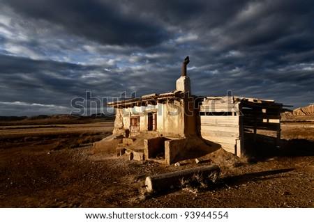 Abandoned house landscape dramatic cloud sky - stock photo