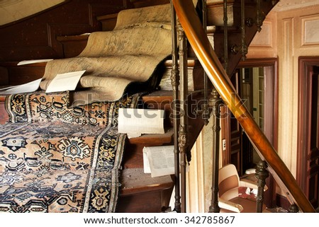Abandoned house with ransacked household - stock photo