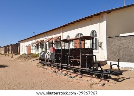 abandoned houses in the ghost diamond town Kolmanskop near L�¼deritz, Namibia, Africa - stock photo