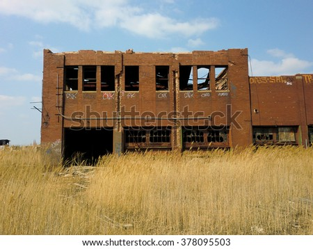Abandoned industrial brick factory warehouse - landscape color photo - stock photo