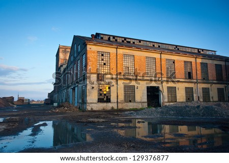 Abandoned industrial plant at sunset, Veneto, Italy - stock photo