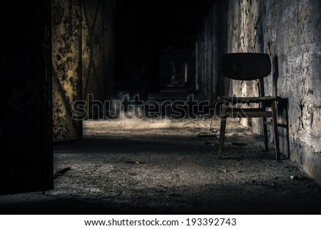 Abandoned interior with chair - stock photo