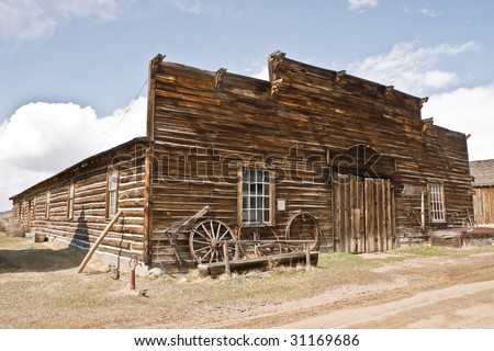 Abandoned mercantile with wagon wheels in front in the ghost town of Nevada City, Montana - stock photo
