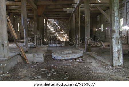 Abandoned Mill, the old mill, millstones - stock photo