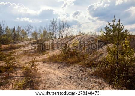 Abandoned mine - damaged landscape after mining. - stock photo