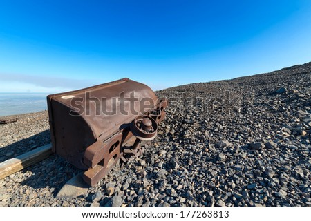 Abandoned mine trolley on the hillside. - stock photo