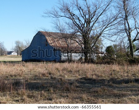 abandoned old farm buildings barn - stock photo