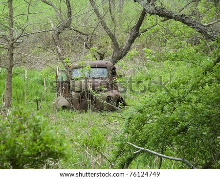 abandoned old farm truck - stock photo