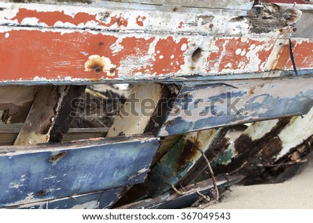 Abandoned old fishing boat in low tide in France, near the atlantic - stock photo