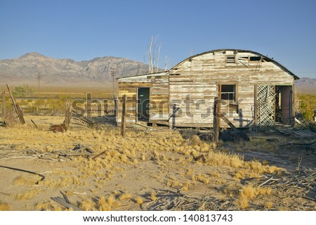 Abandoned old mining buildings in mining area of Mojave Desert in Southern California - stock photo
