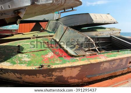 Abandoned old motor boats - stock photo