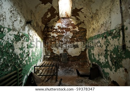 abandoned old prison cell - stock photo