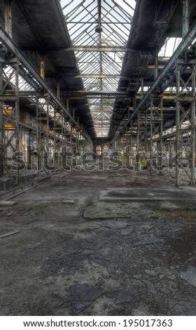 Abandoned old production hall with many plants and steel beams - stock photo