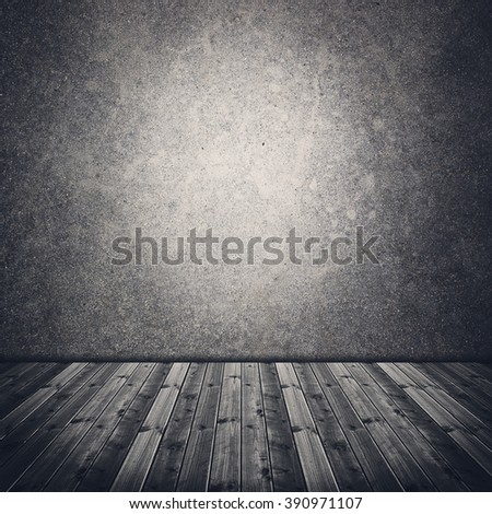 Abandoned old room with concrete wall and wooden floor - stock photo