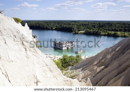 Abandoned open cast sand mine as swimming place - stock photo
