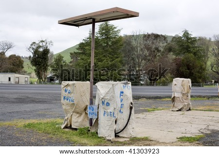 Abandoned Petrol Station with No Fuel signs covering the pumps, victim of the economic crisis - stock photo