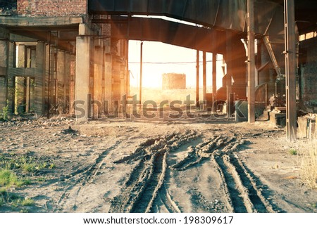 Abandoned place. An old  indastrial building - stock photo