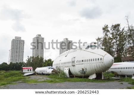 Abandoned plane - stock photo
