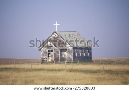 Abandoned prairie church in Wyoming - stock photo