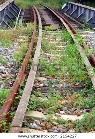 Abandoned Railtracks -- part of a deserted train line - stock photo