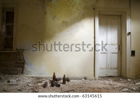 Abandoned Room with a white door - stock photo