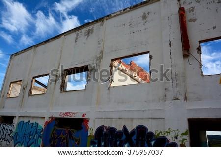 Abandoned ruined old house - stock photo