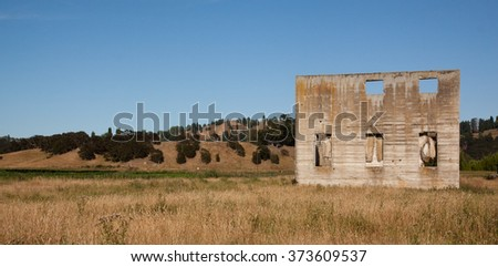 abandoned ruins of the concrete buildings of the former Waipoa Freezing Works, Kaiteritahi, Gisborne, North Island, New Zealand  - stock photo