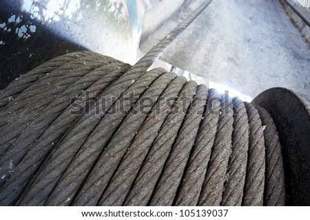 Abandoned rusty steel cable. - stock photo
