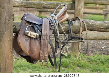 abandoned saddle - stock photo