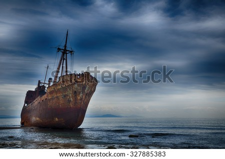 Abandoned ship on the beach, failure concept - stock photo
