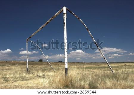 abandoned soccer goal - stock photo