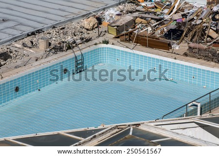 Abandoned swimming pool in a hotel - stock photo
