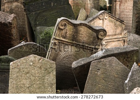 Abandoned tombstones at the Old Jewish Cemetery in Prague, Czech Republic. - stock photo