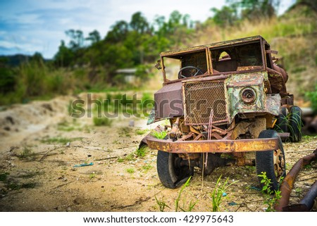 Abandoned truck, rusted in abandoned mine scrapyard. - stock photo