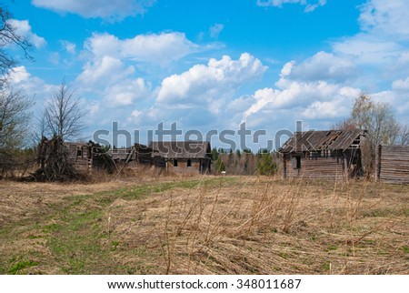 Abandoned village with old destroyed houses - stock photo