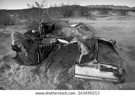 Abandoned vintage auto in the desert, in black and white, Joshua Tree National Park - stock photo