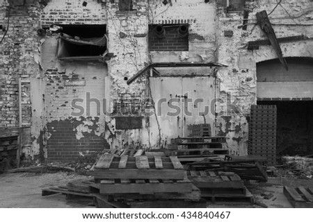 Abandoned warehouse exterior in back and white  - stock photo