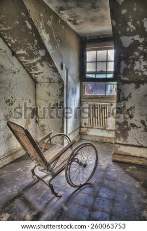 Abandoned Wheelchair at Abandoned Pennhurst Asylum in Pennsylvania - stock photo