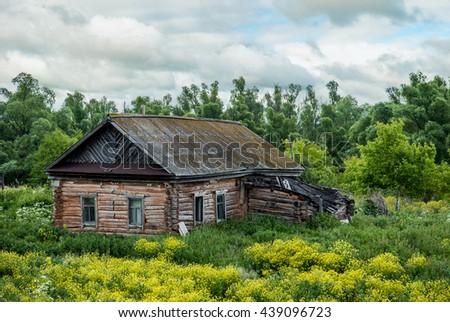 Abandoned wooden house - stock photo