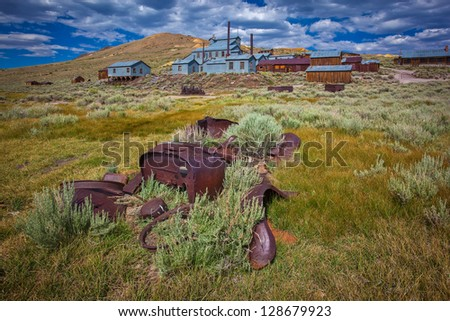 Abandoned wreck and Standard Mill, Bodie Ghost Town, California - stock photo