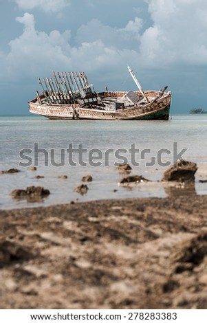 abandoned wrecked ship in seaside - stock photo