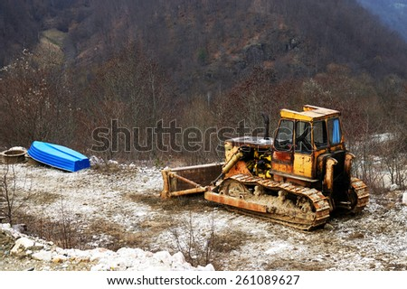 Abandonned bulldozer on a site - stock photo