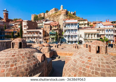 Abanotubani is the ancient district of Tbilisi, Georgia, known for its sulfuric baths. Abanotubani is located at the bank of the Mtkvari (Kura) River. - stock photo